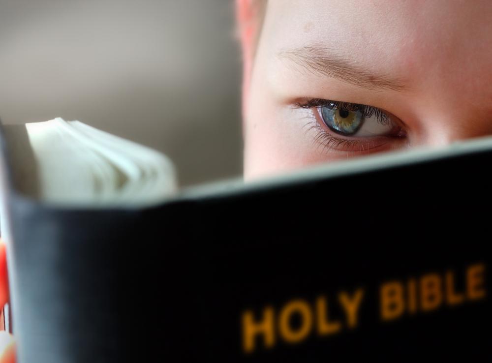 boy-reading-bible-shutterstock_1219452