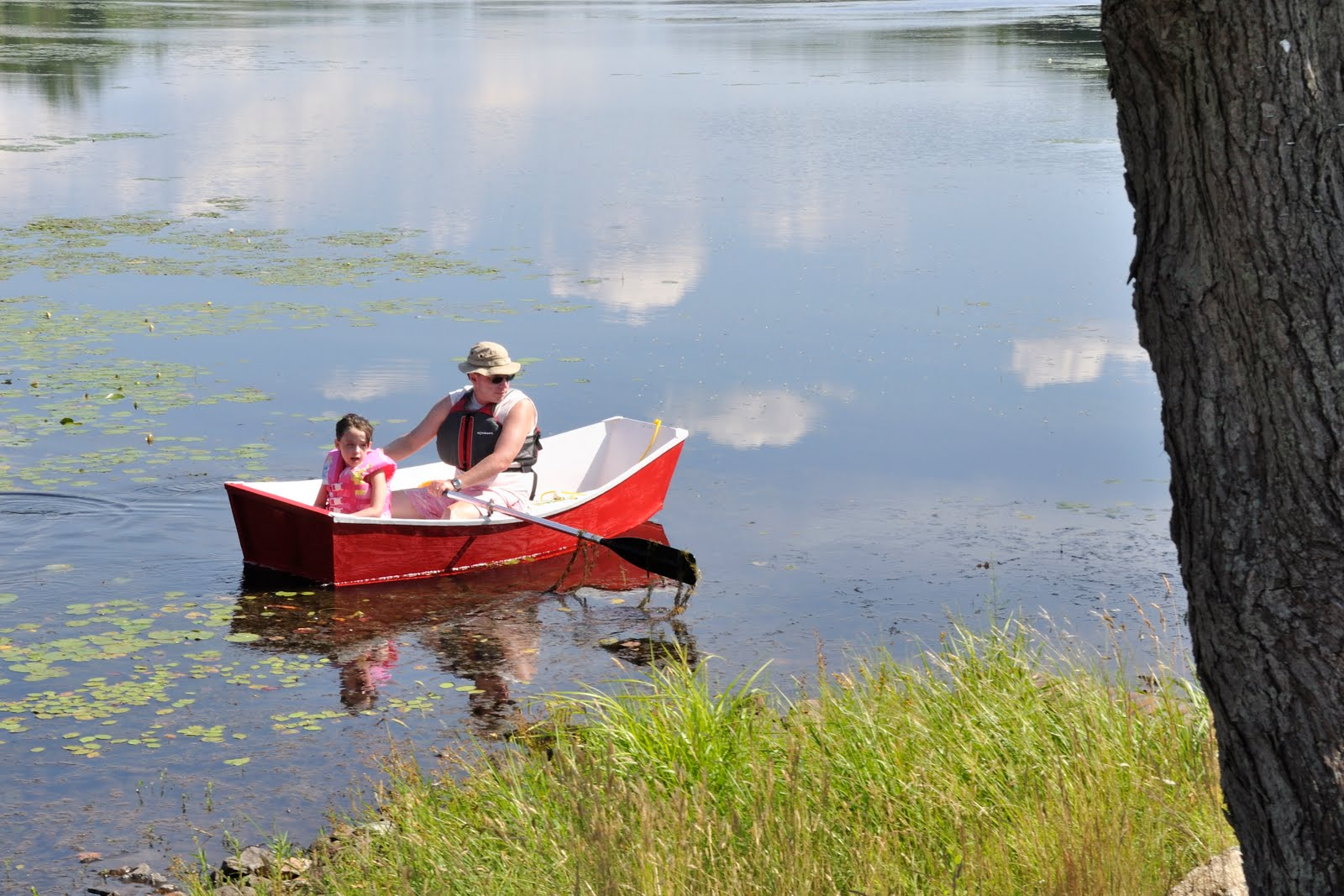 little girl and her dad in row boat